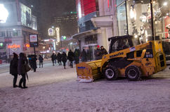 Clearing snow in the sidewalk in Toronto Royalty Free Stock Photography
