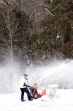 Clearing Snow with a Snowblower Royalty Free Stock Image