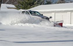 Clearing snow after a winter storm Royalty Free Stock Photography
