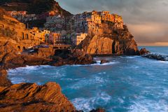 Clearing storm in Manarola. Clearing storm at sunset in Manarola, Cinque Terre, Italy Royalty Free Stock Images
