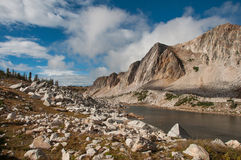 Clearing Storm in the Medicine Bow. The clouds clear out after a storm passed through and the sun brightens the alpine country in the Medicine Bow Mountains of stock photo