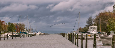 Clearing Storm. View of a storm clearing at a marina Royalty Free Stock Image