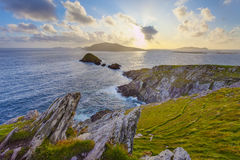 Clearing up. Scenic irish west coast, looking from dingle peninsula (Europe`s most westerly point) in western ireland towards blasket islands while the sky is Stock Photography