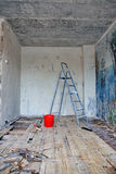 Clearing of walls of wall-paper. Before repair in an apartment Royalty Free Stock Images