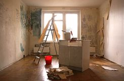 Clearing of walls of wall-paper. Before repair in an apartment Stock Image
