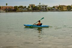 Woman practice kayaking around the Clearwater Beach. stock photography