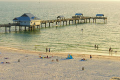 Clearwater Beach high angle. High angle of Clearwater beach with Pier. Evening light with a few people in the water in the distance Royalty Free Stock Photos