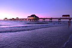 Panoramic view of Pier 60 on magenta sunset background at Cleawater Beach. royalty free stock photography