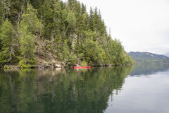 Clearwater lake with canoe Stock Images