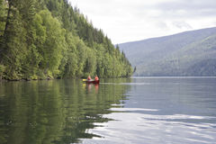 Clearwater lake with canoe Royalty Free Stock Photo