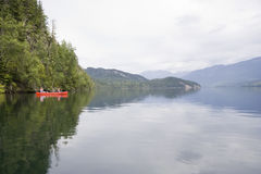 Clearwater lake with canoe Stock Photo