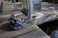 Cleat in a habour. With blue rope Stock Images