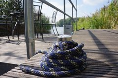 Cleat in a habour. With rope Royalty Free Stock Photo