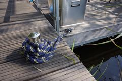 Cleat in a habour. Cleat in a tabour with blue rope Royalty Free Stock Photo