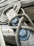 Cleat with Rope. Close up of a rope tied onto cleat dockside Stock Images