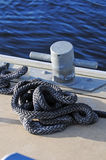 Cleat and rope on dock Royalty Free Stock Images