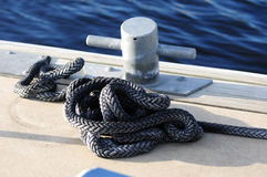 Cleat and rope on dock Stock Photography
