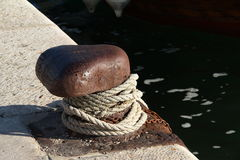 Cleat and rope at sea Royalty Free Stock Images
