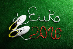 Cleats and Euro 2016 sign against artificial turf Stock Image