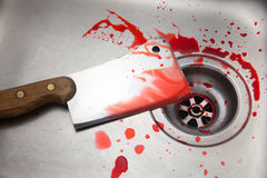 Cleaver and blood in the sink Stock Image