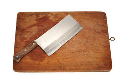 Cleaver On A Chopping Board Royalty Free Stock Images