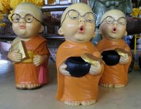 Cleaver little Buddhist monk dolls. Cleaver little monk dolls royalty free stock photography