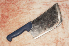 Cleaver On Stained Countertop Stock Photography