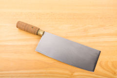 Cleaver on Wood Cutting Board Royalty Free Stock Images