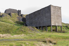 Clee Hill disused stone quarry loading bay. Concrete ruins. Royalty Free Stock Image