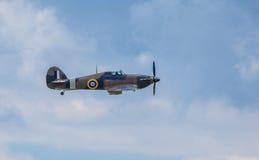 Cleethorpes England - Juli 28, 2013: GatuförsäljareHurricane flygplan Arkivbilder
