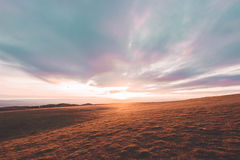 Cleeve-Hügelsonnenuntergang Stockbild