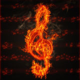 Clef on fire. Illustration of clef on fire on the background of music score sheet Royalty Free Stock Photos