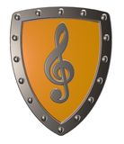 Clef on metal shield Stock Image