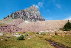 Clement Mountain as seen from Hidden Lake trail on Logan Pass in Glacier National Park during the 2017 fall fires in Montana USA. Clement Mountain as seen from Royalty Free Stock Photos