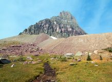 Clement Mountain as seen from Hidden Lake trail on Logan Pass in Glacier National Park during the 2017 fall fires in Montana USA. Clement Mountain as seen from Stock Images