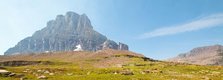 Clement Mountain as seen from Hidden Lake trail on Logan Pass in Glacier National Park during the 2017 fall fires in Montana USA. Clement Mountain as seen from Stock Photos