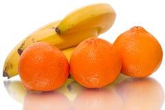 Clementinas y plátanos Imágenes de archivo libres de regalías