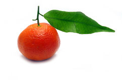 Clementine. A fresh clementine isolated on white stock images