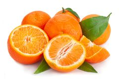 Clementine citrus fruit on white. Clementine citrus fruit closeup isolated on white royalty free stock photo