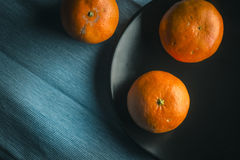 Clementine fresh fruits, moody and dark Royalty Free Stock Photos