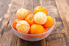 Clementine. Fresh clementine on wood background stock photography
