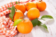 Clementine and leaf Royalty Free Stock Photos