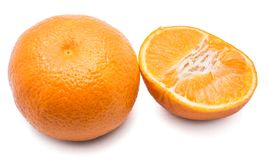 Clementine. One whole and Clementine half on white backgroundn stock photography