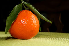 Clementine orange. With green stem and leaves Royalty Free Stock Images