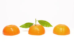Clementine orange cut. Fresh clementine orange cut with green leaves Stock Photo