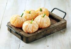 Clementine Oranges Decorated Like Pumpkins Lizenzfreie Stockbilder