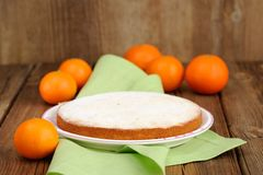 Clementine pie with clementines on wooden background Royalty Free Stock Image