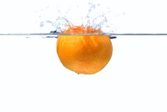 Clementine splash. Ing down into some water, slight motion blur stock image