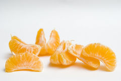 Clementine wedges. Clementine segments scattered throughout the image Stock Photo