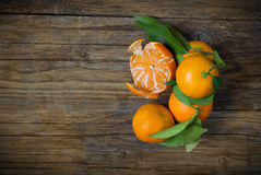 Clementine on wood Stock Photography
